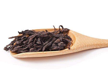 stock-photo-famous-chinese-oolong-tea-da-hong-pao-in-the-bamboo-scoop-isolated-on-white-background-177606734.png